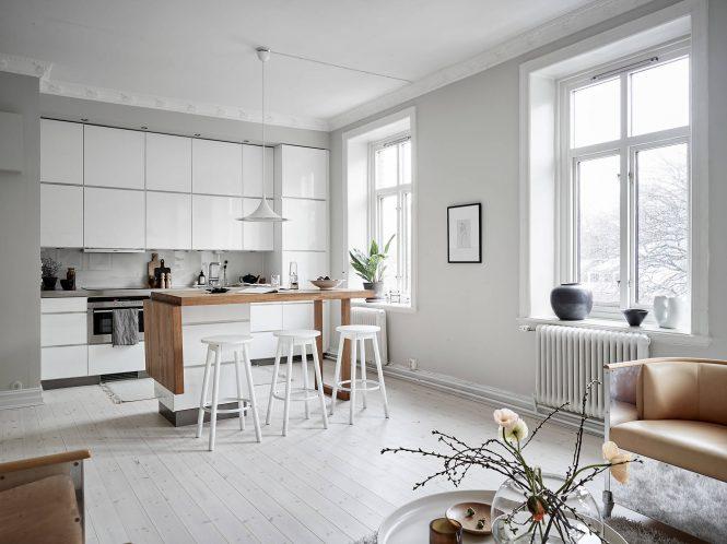 Cocina nórdica elegante con isla portátil